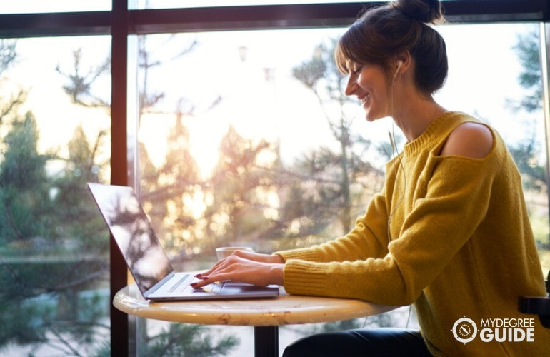 Master's in Mental Health Counseling Degree student studying on her laptop