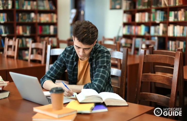 Mechanical Engineering student studying in a library