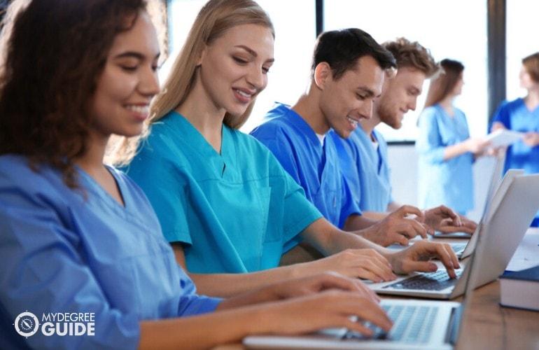 nurses studying on their laptop
