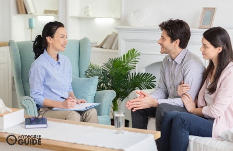 Marriage Therapist talking to a couple in her office