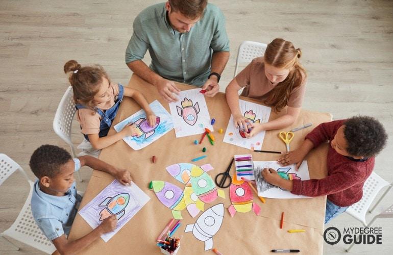 Elementary Art Education teacher having art with his students