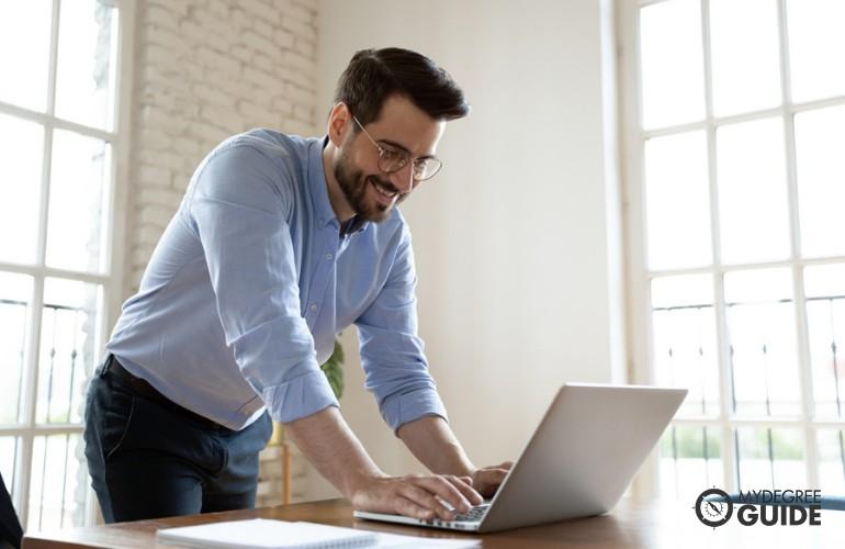 Economist working on his laptop