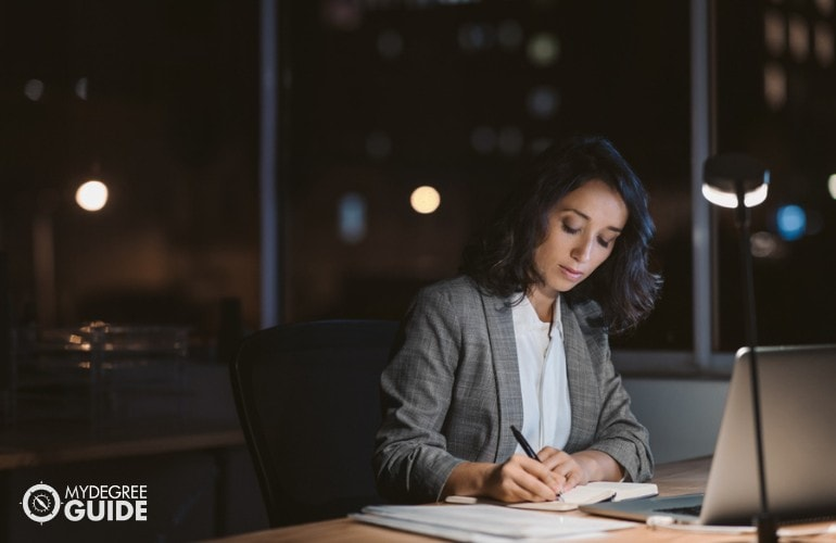 Education Curriculum Planner working in her offcie