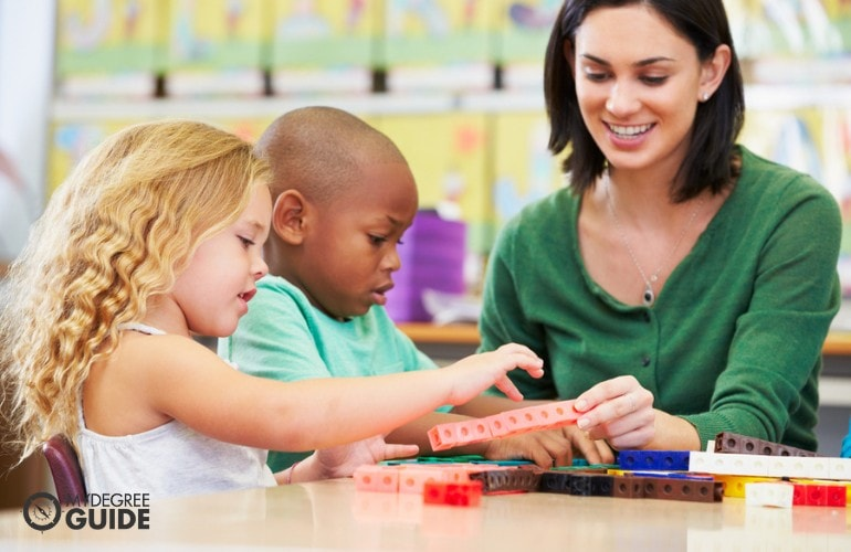 Preschool Teacher playing with her students
