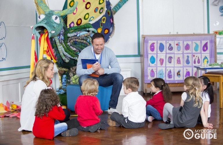 Preschool Teacher with his students in class