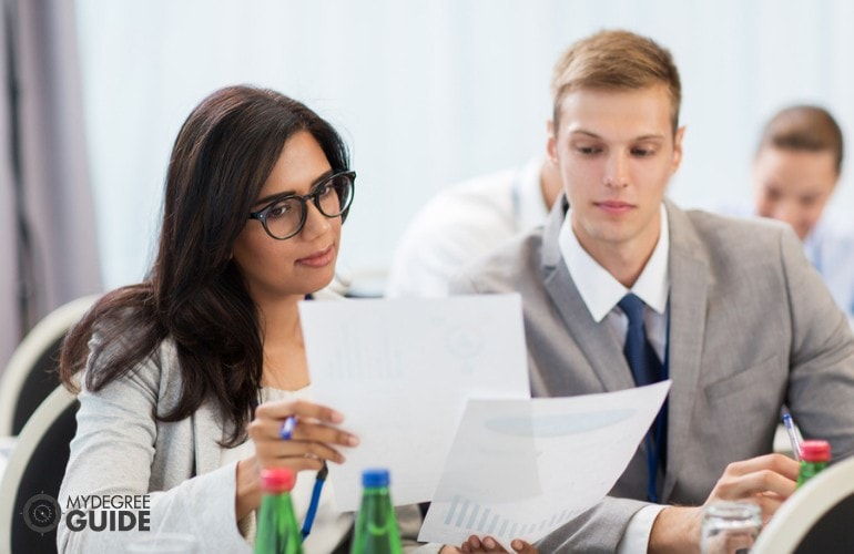 Instructional Coordinators working in an office
