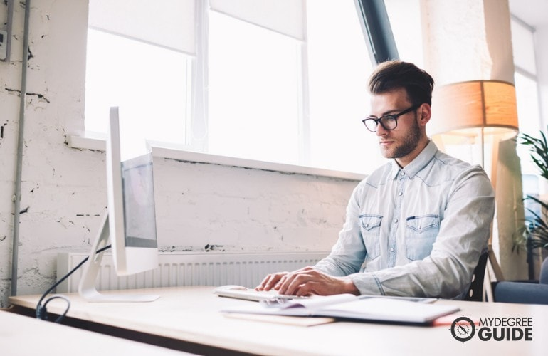 Masters Degree in Education student researching online