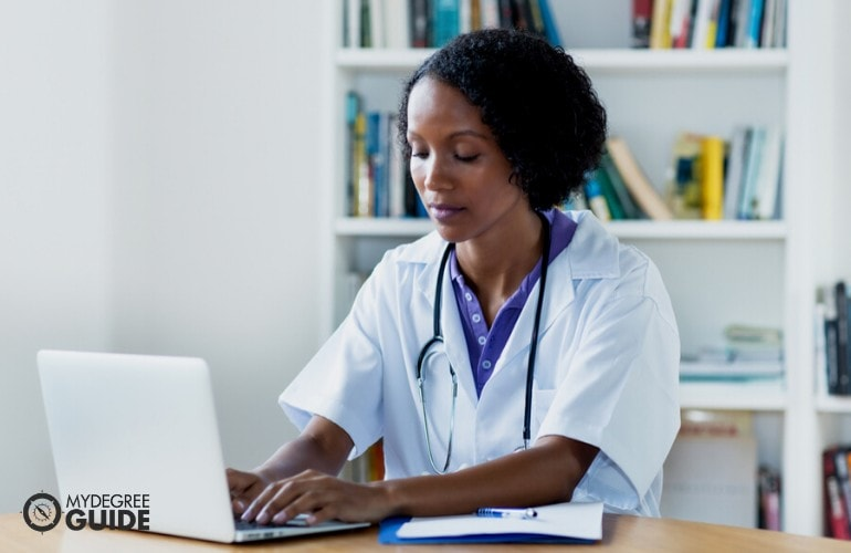 Healthcare Management Doctorate student studying on her laptop