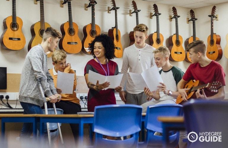 Music Teacher teaching students during Music class