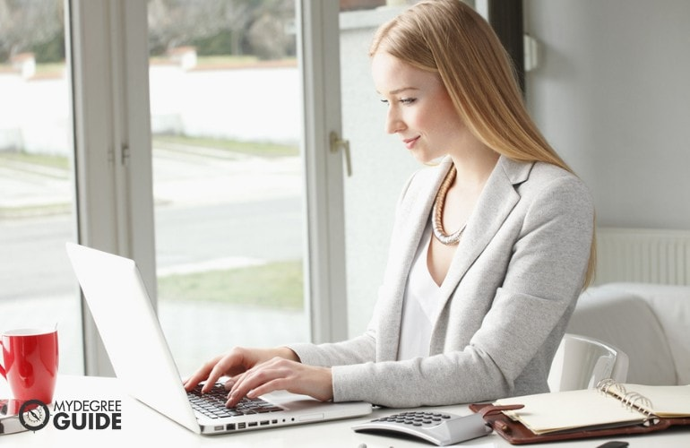 Education Curriculum designer working on her laptop