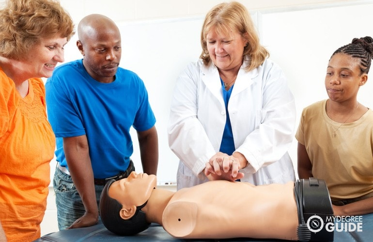 Nursing Educator teaching CPR to volunteers in community