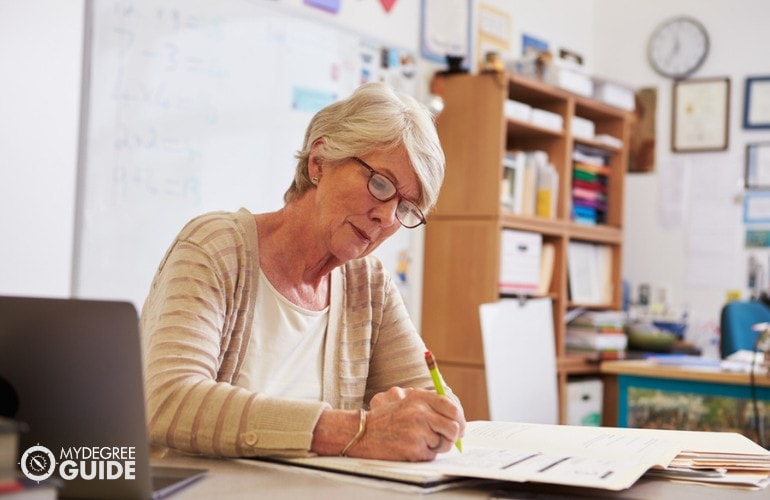 Education Administrator for Elementary working in her office