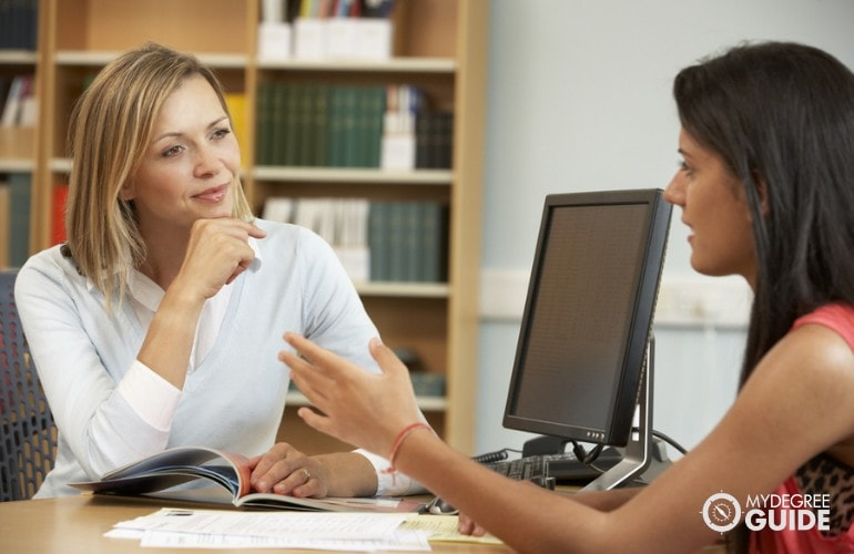 School Career Counselor giving advice to a student