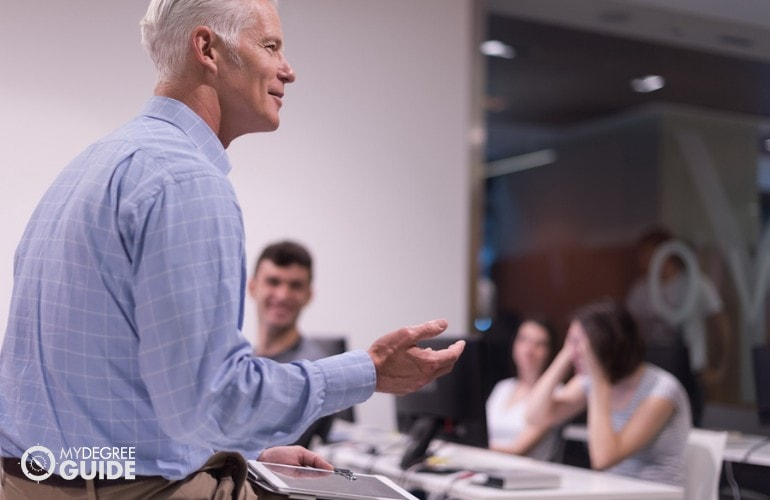 professor teaching college students in a university