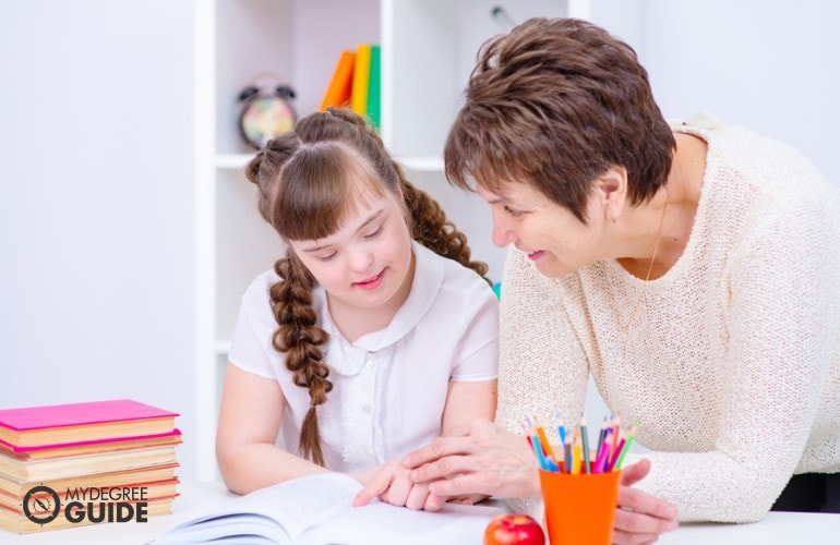 Special Education teacher teaching a child with down syndrome