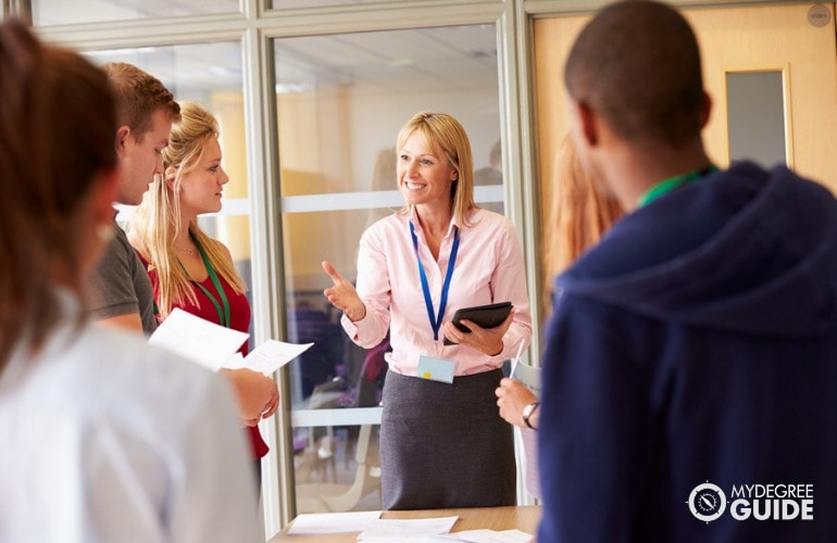College Professor giving instructions to her students