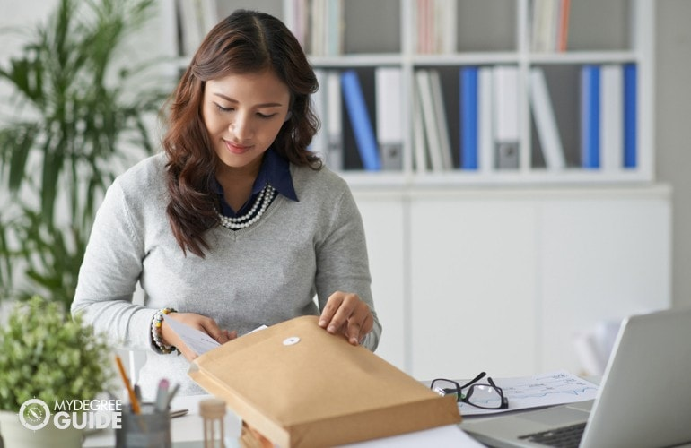 female mailing a large envelope