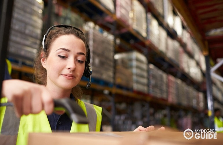 Logistician checking barcodes of products
