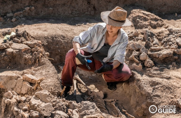 Anthropologist checking the historical site