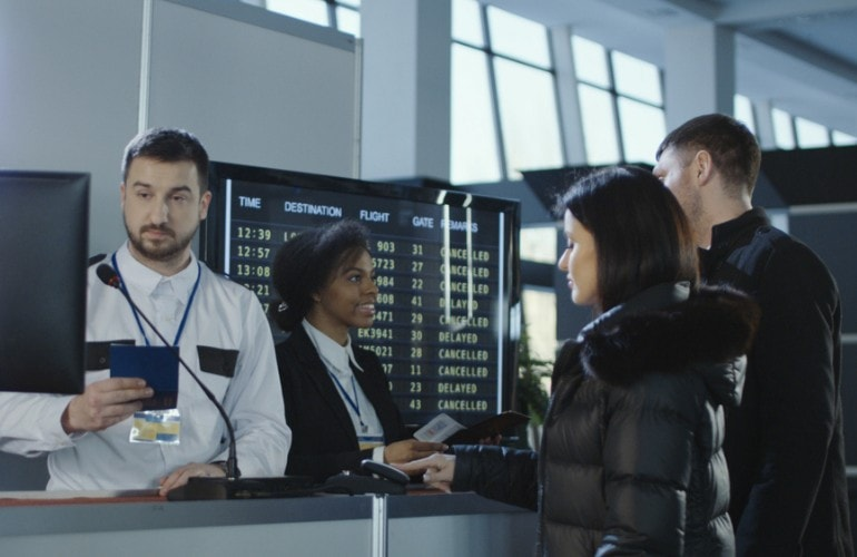 immigration officers checking passengers in airport