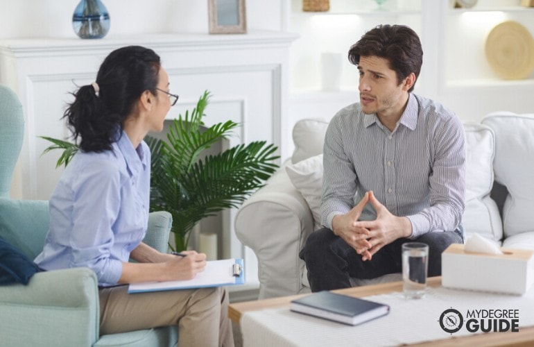 psychologist talking to a patient in the office