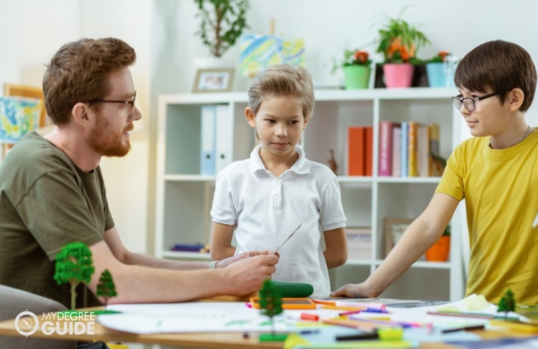 Special Education teacher teaching children with special needs
