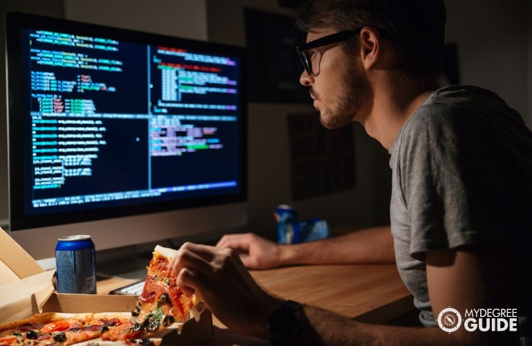 Computer Programmer eating while working