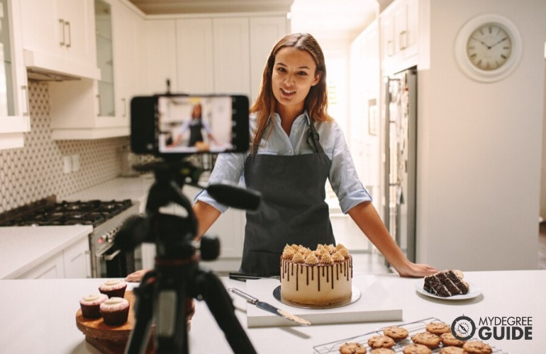 female baker vlogging herself to market her business