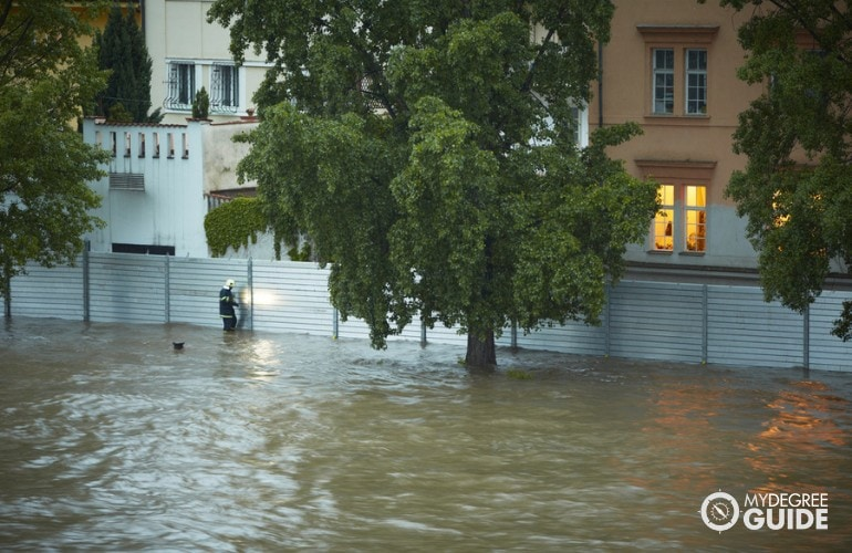 someone checking the community safety during flood