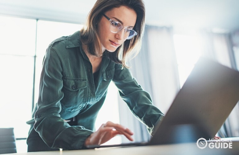 Doctorate in Higher Education student researching online