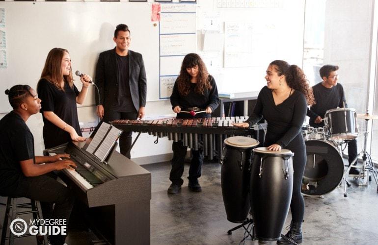 College Music teacher teaching students in university