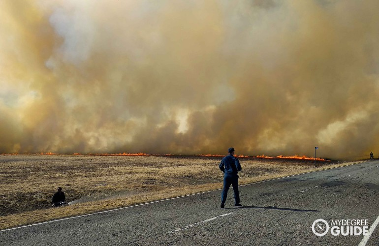 firefighters trying to control the wildfire