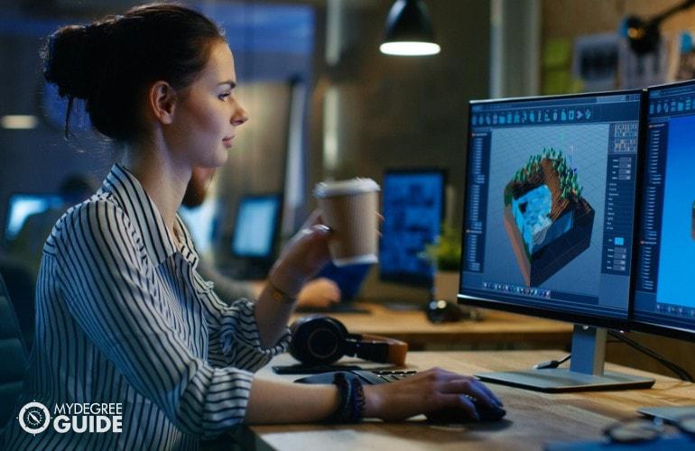 Multimedia Artist working in an office