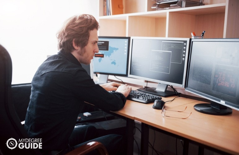 Game Developer working in his office