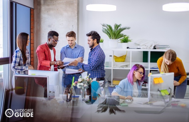 marketing team discussing in an office