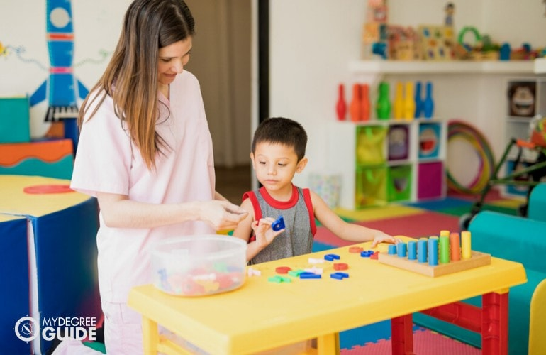 Special Education teacher teaching a child with special needs