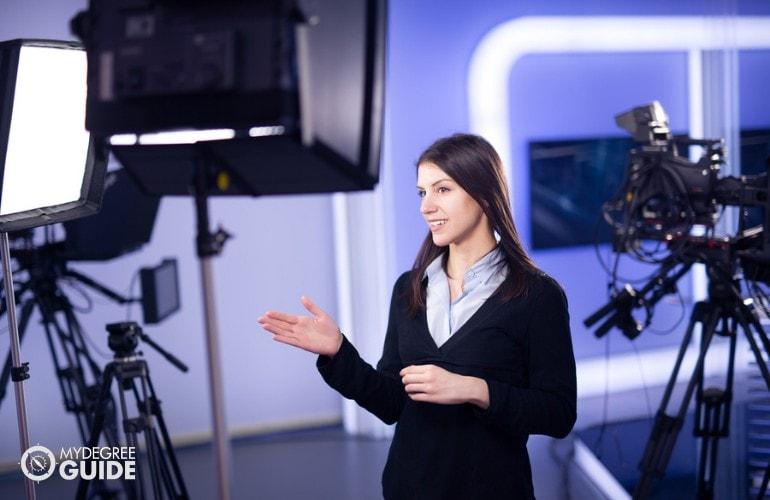 News Analyst working in a studio
