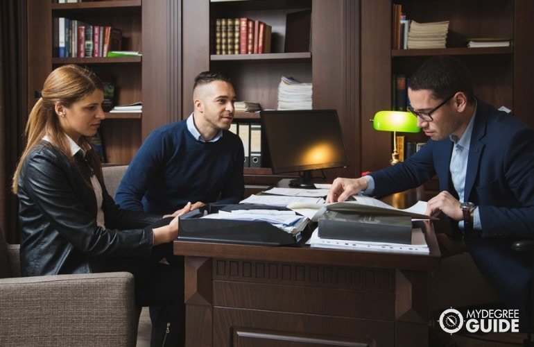 Lawyer meeting with clients in his office