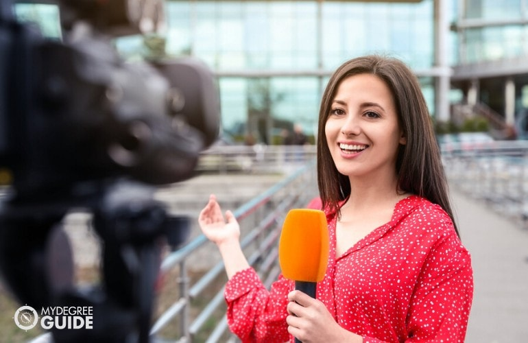 News Correspondent delivering the news