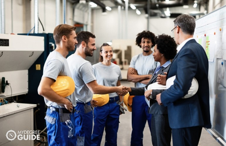 Industrial Production Managers meeting with workers