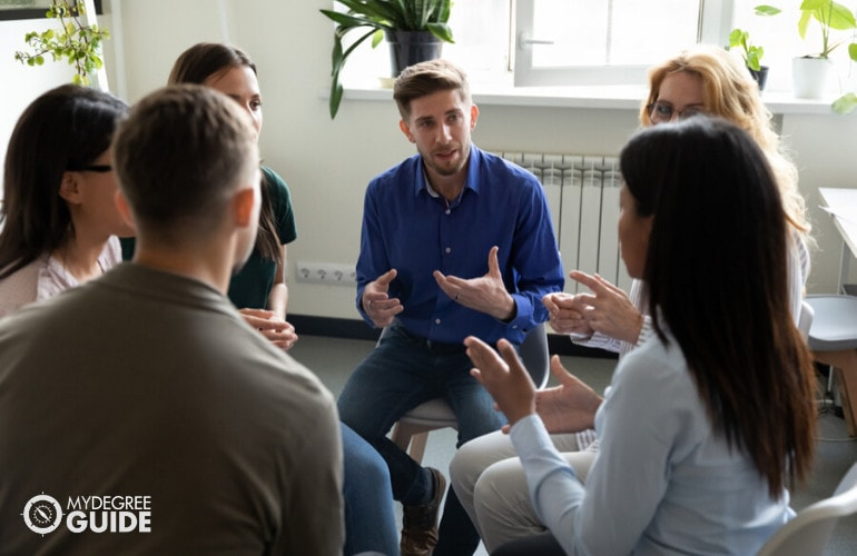 Addiction Counselor with patients during group counseling