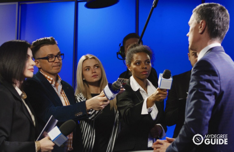 Broadcast News Analysts interviewing a politician