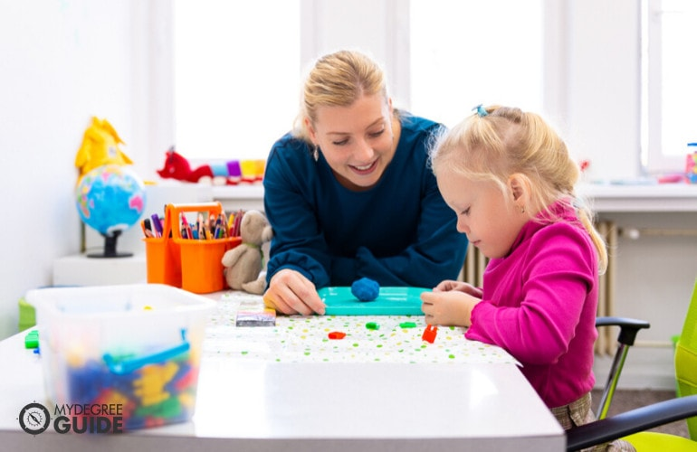 Child Psychologist playing with a child
