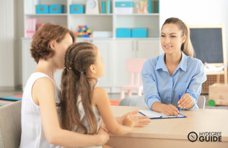 Child Psychologist talking to parent and child