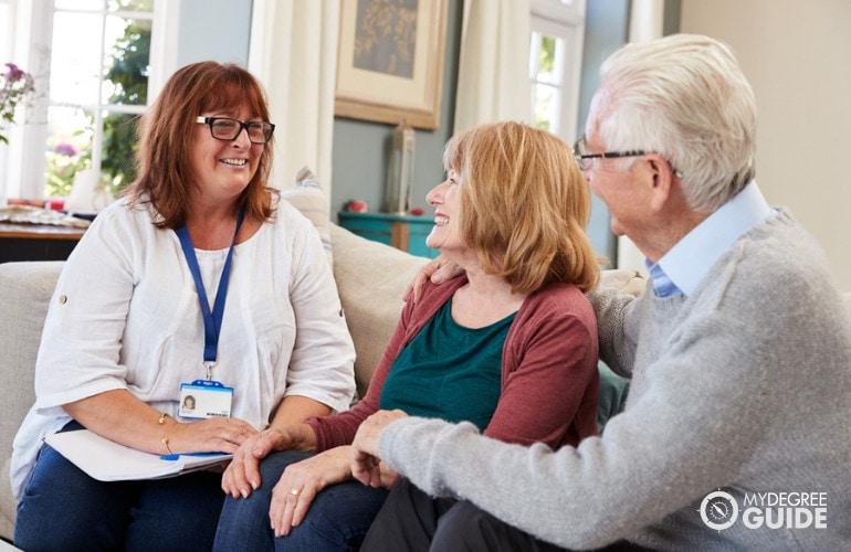 Social worker visiting an elderly couple