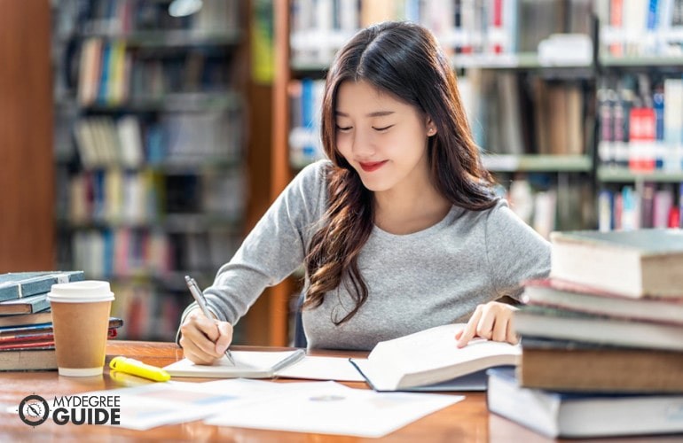 Forensic Psychology student studying in library