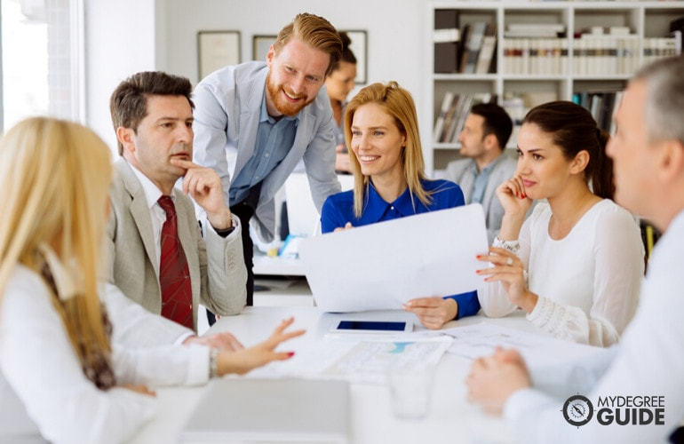 Project Manager meeting with his team