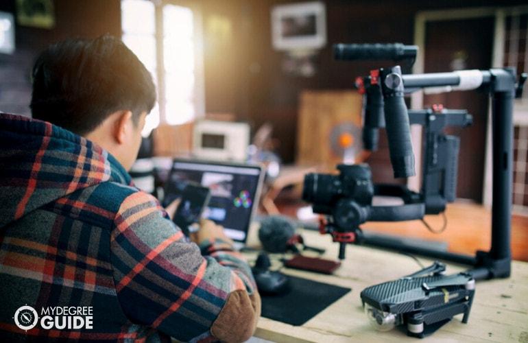 film maker working in an office