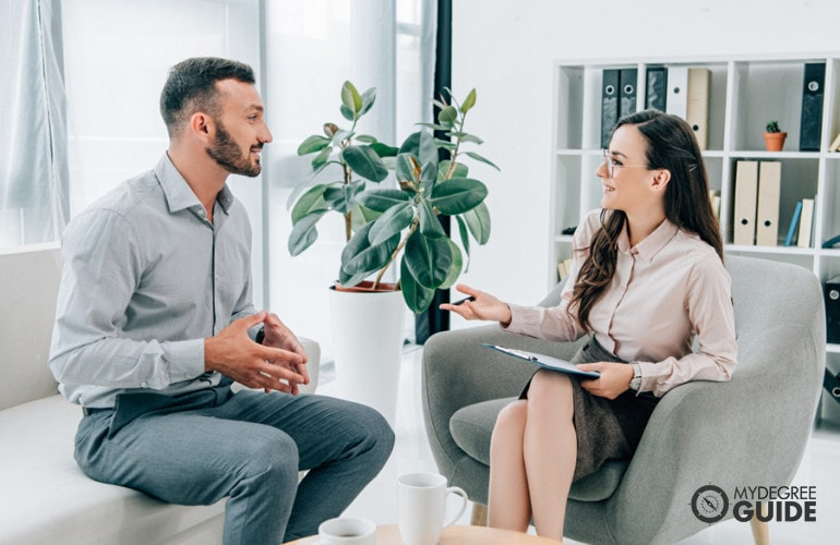 Psychologist with a client during consultation