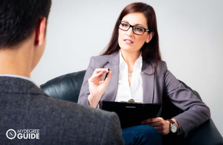 Forensic Psychologist having a consultation with a patient